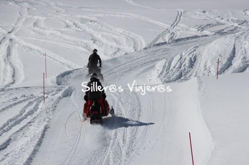 Con las motos de nieve