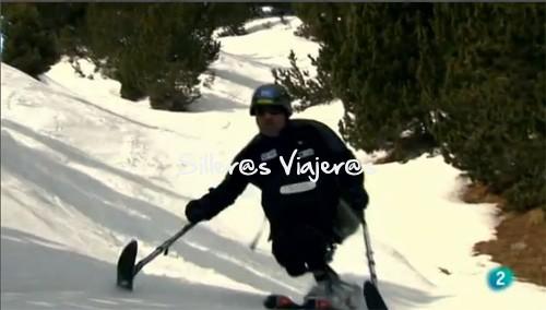 Descenso esquiando con silla
