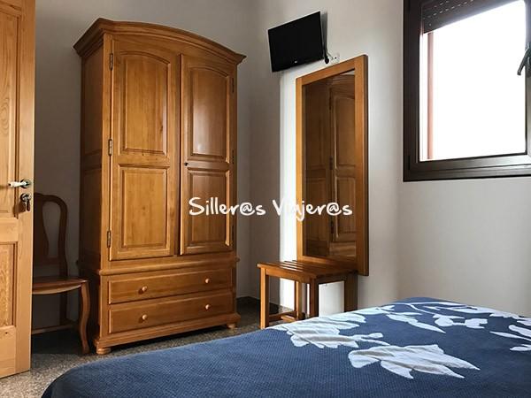 Espacio del dormitorio colgadores del armario